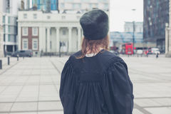 Woman in hat and graduation gown Stock Photo
