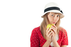 Woman in hat holding apple Royalty Free Stock Images