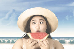 Woman with hat holding watermelon Royalty Free Stock Photos
