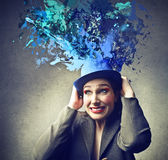 Woman with a hat. Woman holding a hat whose coming out colours Royalty Free Stock Photography