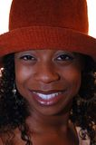 Woman in hat II. Beautiful African American woman in red hat Stock Image