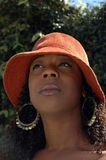 Woman in hat III. Beautiful African American woman in red hat shot from below Stock Photos