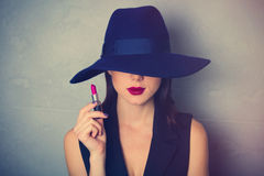 Woman in hat with lipstick Stock Images