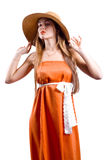 Woman in hat in long dress Stock Image