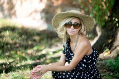 Woman in a hat. In long polka dot dress. Retro italian style stock photos