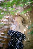 Woman in a hat. In long polka dot dress. Retro italian style royalty free stock images