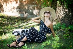 Woman in a hat. In long polka dot dress. Retro italian style royalty free stock photography
