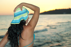 Woman with hat looking in profile on beach Stock Photography