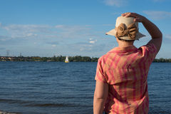 Woman in a hat looks afar. Woman in a straw hat looks afar Royalty Free Stock Photo