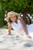 Woman with hat lying on white sand Royalty Free Stock Images