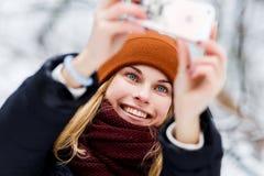Woman in hat making selfie stock photo