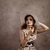 Woman in hat with martini Royalty Free Stock Photography