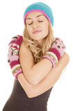 Woman hat mittens arms folded Royalty Free Stock Image