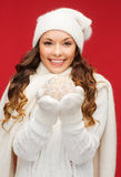 Woman in hat and mittens with christmas ball Stock Image