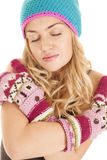 Woman hat mittens eyes closed serious Royalty Free Stock Photo