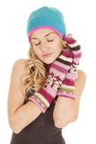 Woman hat mittens yes closed hands face Royalty Free Stock Image