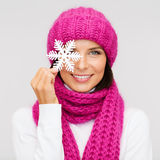 Woman in hat and muffler with big snowflake Royalty Free Stock Photos