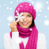 Woman in hat and muffler with big snowflake Stock Photo