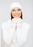 Woman in hat, muffler and gloves Royalty Free Stock Image