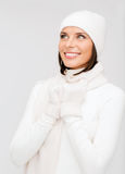 Woman in hat, muffler and gloves Royalty Free Stock Photos