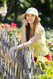 Woman in hat near fence Royalty Free Stock Image