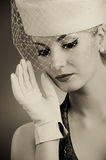Woman in hat with net veil Royalty Free Stock Images