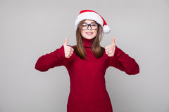 Woman with hat okey gesture. Woman with Christmas hat okey gesture Royalty Free Stock Images
