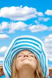 Woman with a hat outdoors Stock Photography