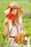 Woman in hat with poppy bouquet Stock Images