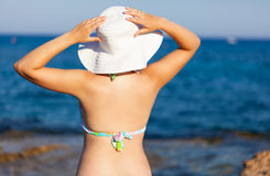 A woman in hat is posing Royalty Free Stock Photos