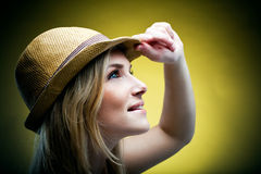 Woman with hat. Pretty woman looking at something while touching her hat Stock Photos