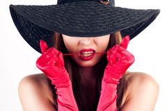 Woman in a hat and red gloves Stock Photos