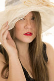 Woman hat red lipstick black top look serious Royalty Free Stock Photo