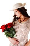 Woman with hat and red roses. Royalty Free Stock Photo