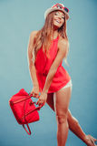 Woman in hat and red shirt with handbag sunglasses Stock Photos
