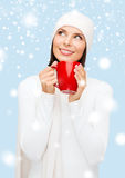 Woman in hat with red tea or coffee mug Royalty Free Stock Photo