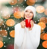 Woman in hat with red tea or coffee mug Stock Image