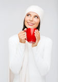 Woman in hat with red tea or coffee mug Stock Photography