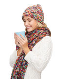 Woman in hat with red tea or coffee mug Royalty Free Stock Image
