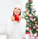 Woman in hat with red tea or coffee mug Stock Images