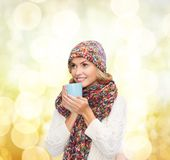 Woman in hat with red tea or coffee mug Royalty Free Stock Images