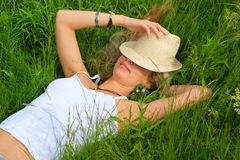 Woman with hat relaxing Royalty Free Stock Images