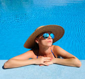 Woman at poolside Royalty Free Stock Photos
