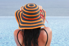 Woman in hat relaxing at the pool Royalty Free Stock Image