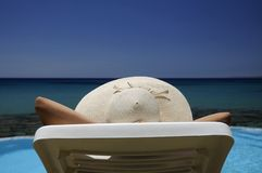 Woman in a hat resting over the sea Royalty Free Stock Photography