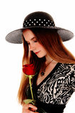 Woman with hat and rose. Royalty Free Stock Image