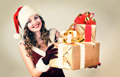 woman in and hat of Santa with a gift Stock Photos