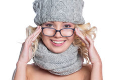 Woman in a hat, scarf and glasses Stock Photos