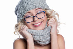 Woman in a hat, scarf and glasses Royalty Free Stock Photos