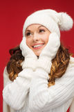 Woman in hat, scarf and mittens Stock Image